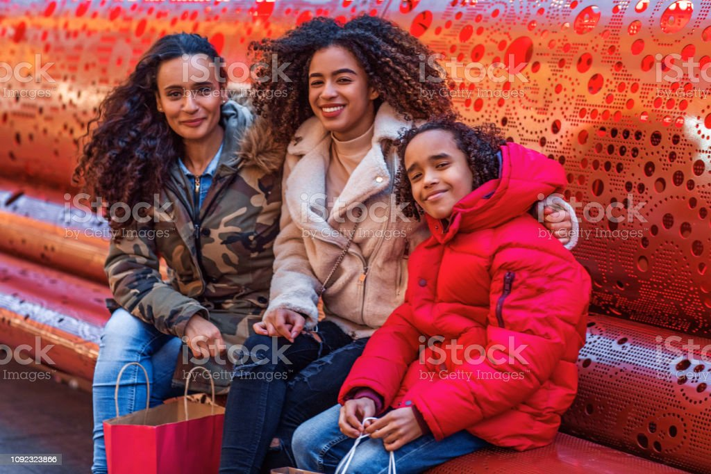 Beautiful mixed race mother and children enjoying shopping in the...