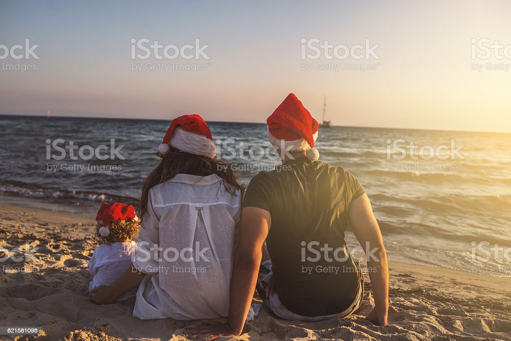 Family Christmas time at the beach stock photo