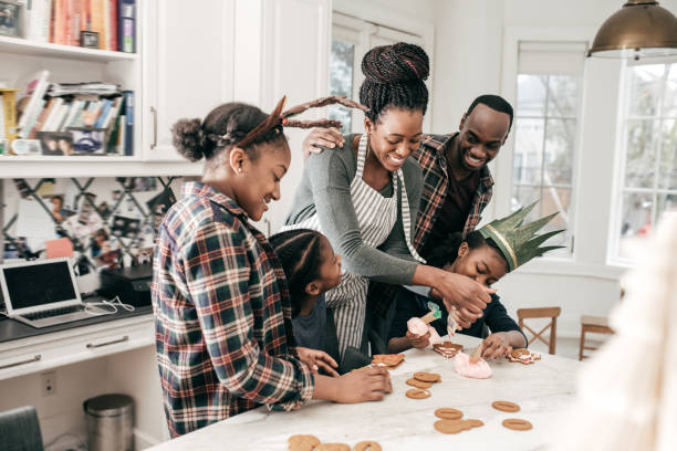 Family Christmas traditions - sugar cookies Family baking together tradition stock pictures, royalty-free photos & images