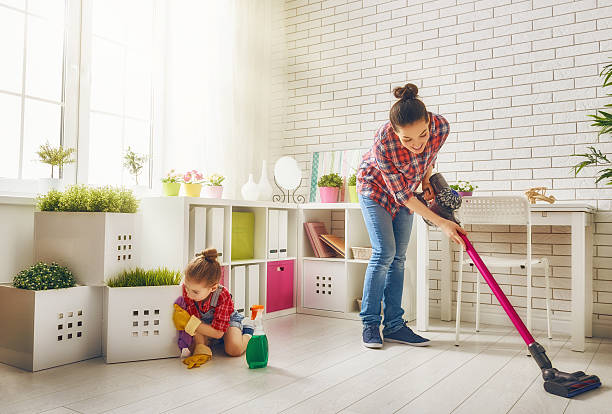 family cleans the room - stofzuiger stockfoto's en -beelden