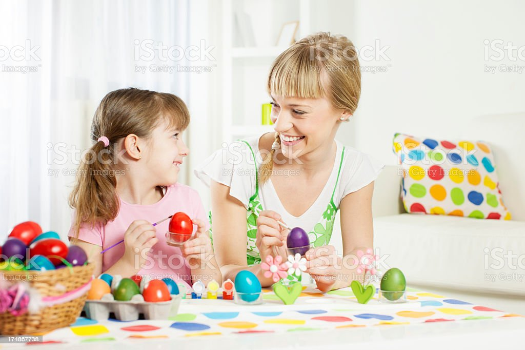 Family Coloring Easter Egg. royalty-free stock photo