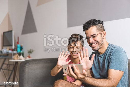 Family communicating by video conference during the Coronavirus quarantine in 2020.
