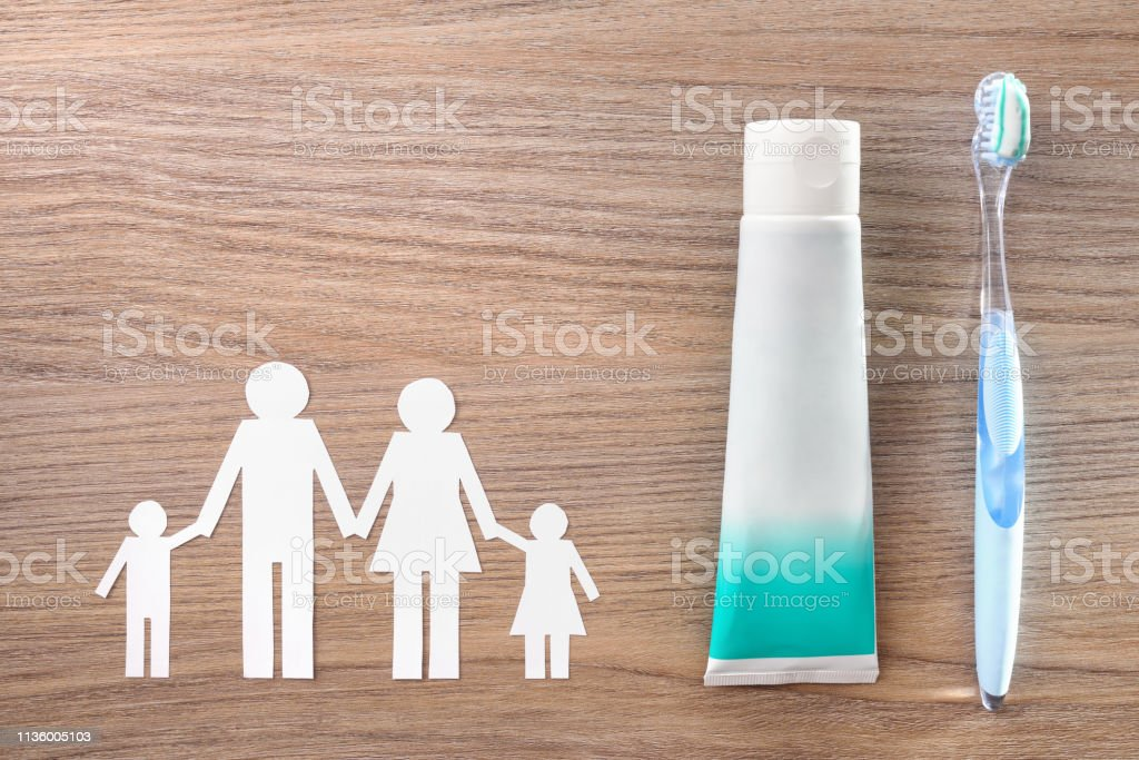 Family concept of dental hygiene tools on wood table top stock photo