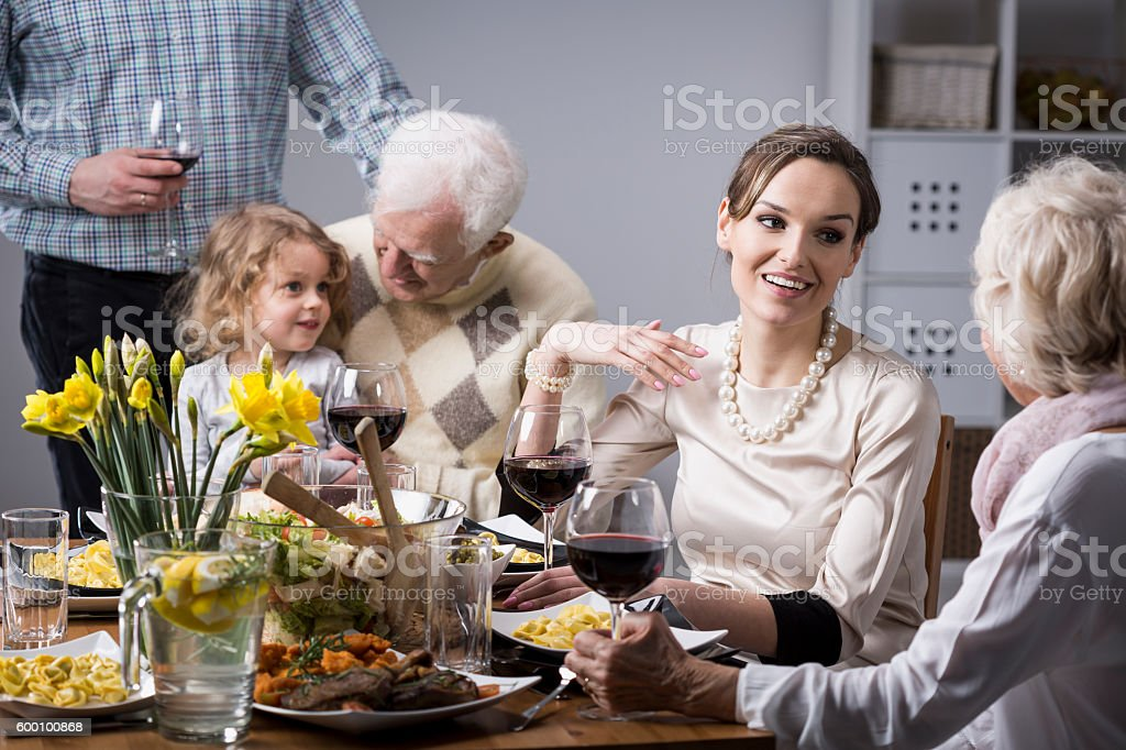 Family conversations at the table stock photo