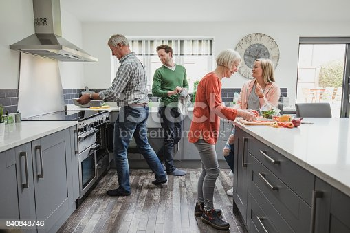 istock Family Cooking A Meal 840848746