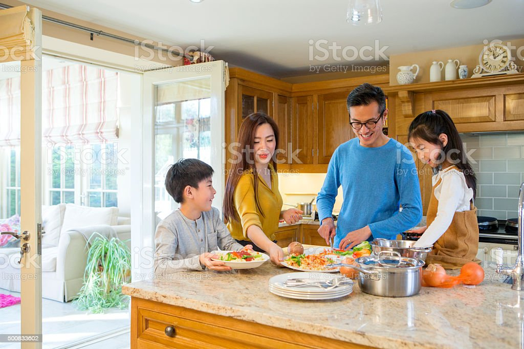 Family Cooking Dinner Together stock photo