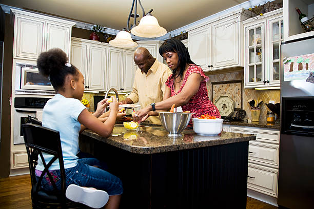 A family cooking in the kitchen stock photo