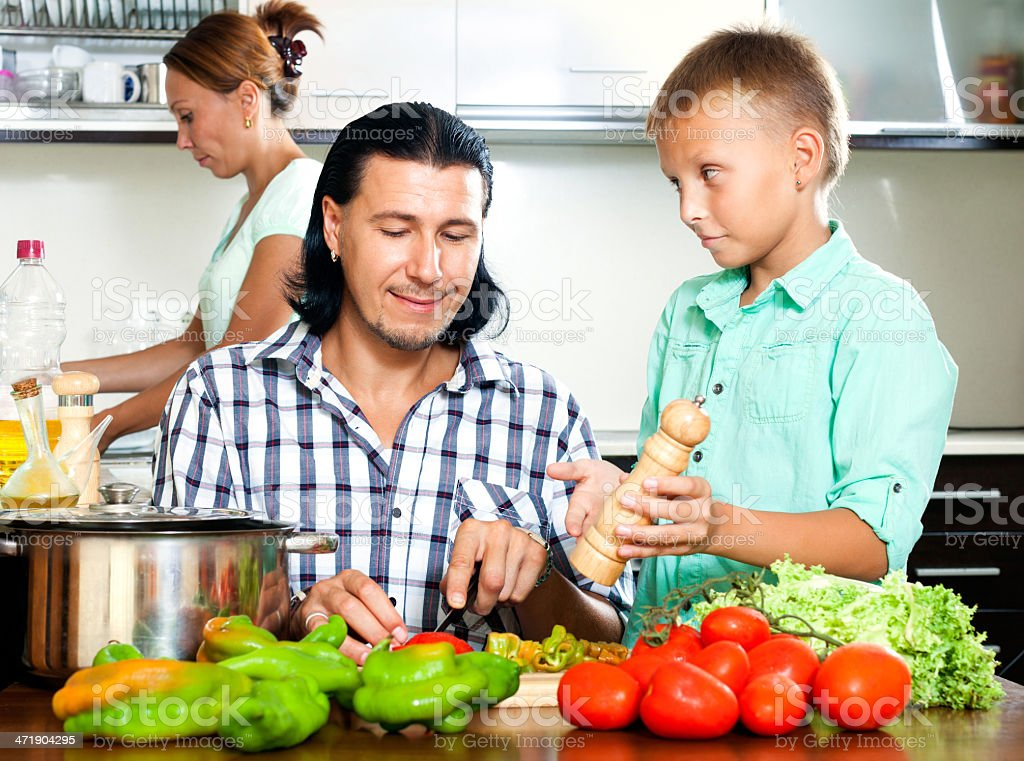 Family cooking in the kitchen stock photo