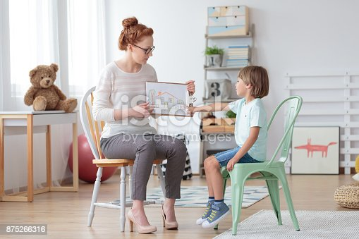 istock Family counselor helping young child 875266316