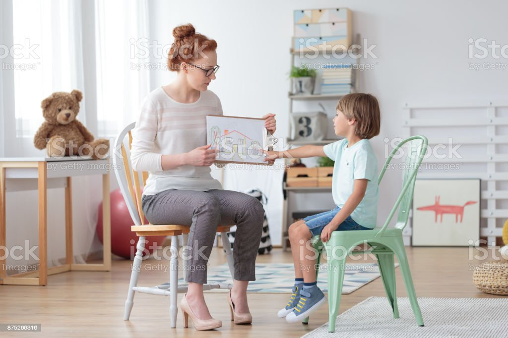 Family counselor helping young child stock photo