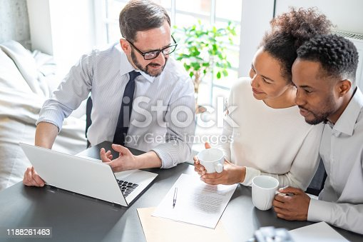 994164754 istock photo Family couple consultations with a lawyer or insurance agent. 1188261463