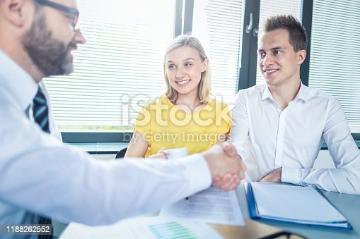 994164754 istock photo Family couple consultations with a lawyer or insurance agent. 1188262552