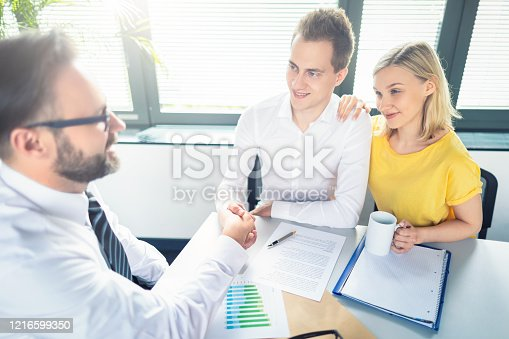 963814372 istock photo Family couple consultations with a lawyer or insurance agent. 1216599350
