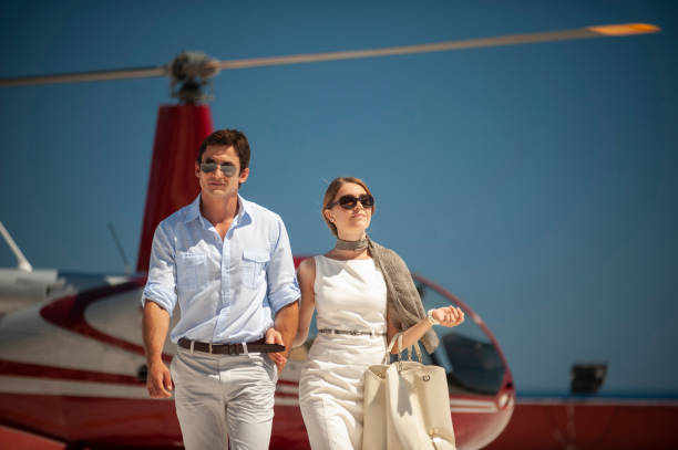 Family couple on vacation trip by helicopter stock photo