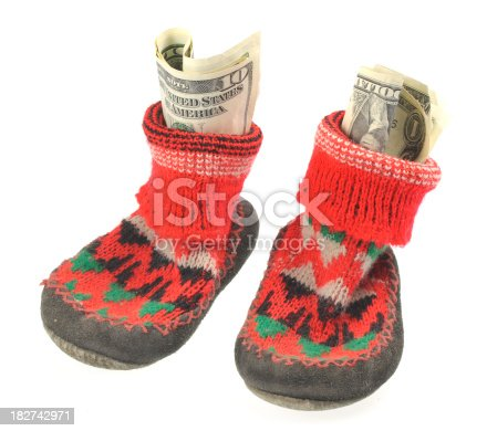 istock family  credit in shoes with dollar notes 182742971