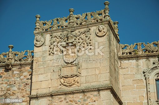 istock Family crest carved on a stone tower 1132599840