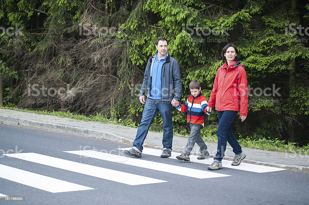 Family crossing the Road stock photo