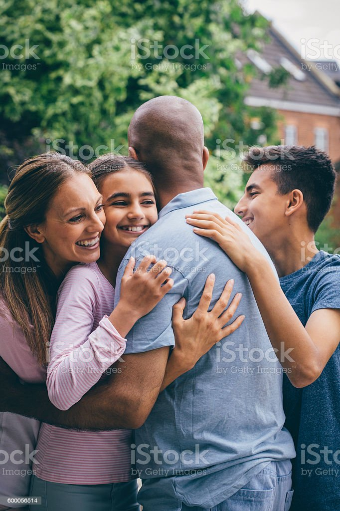 Family Cuddle Outdoors stock photo