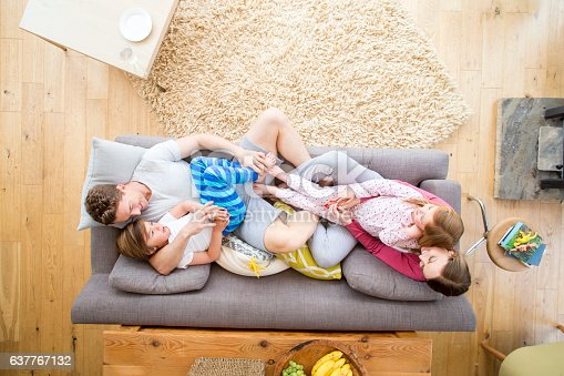 istock Family Cuddles on the Sofa 637767132