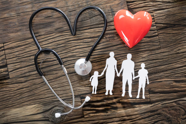 Family Cut Out And Red Heart On Desk stock photo