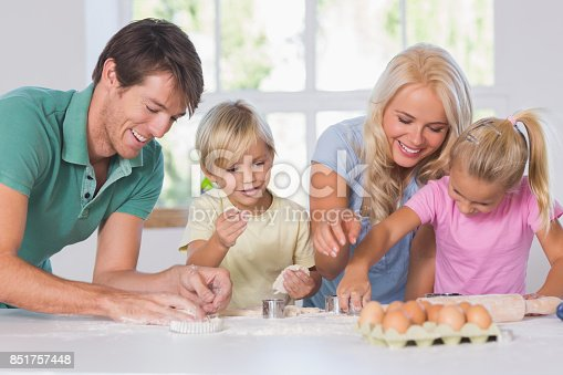istock Family cutting the dough 851757448