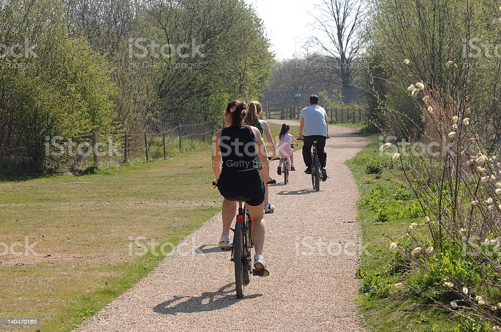 family cycling on a summers day royalty-free stock photo