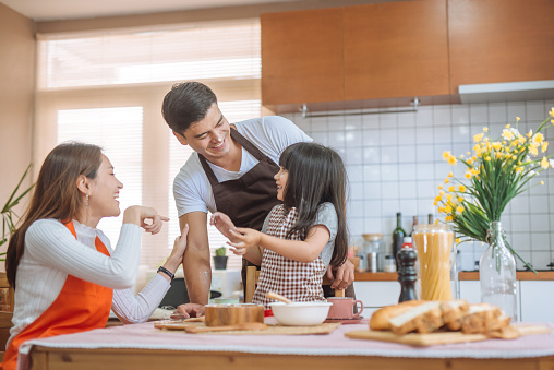 istock Family Daughter and parent preparing the bake 1094299686