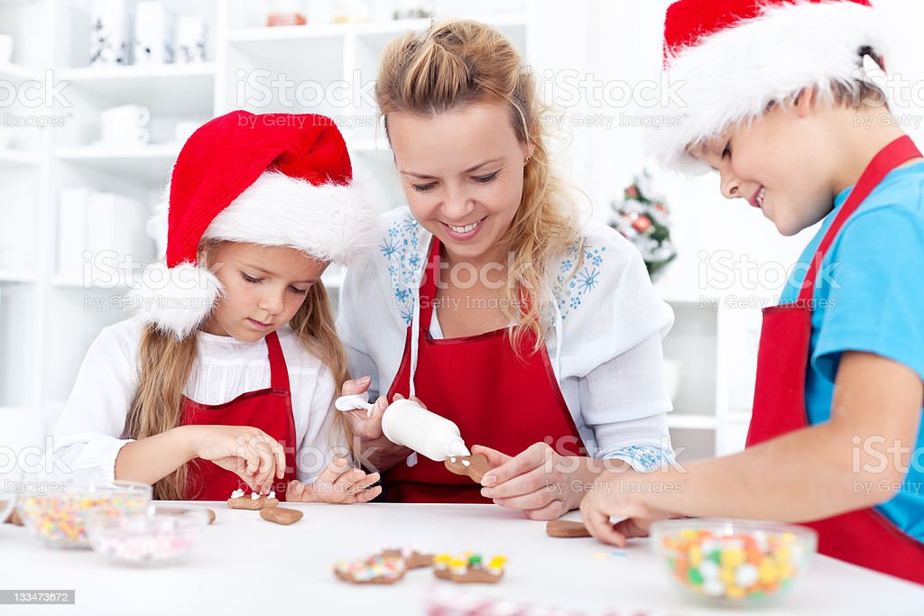 Family decorating christmas cookies royalty-free stock photo
