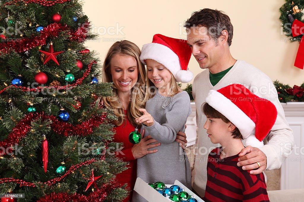 Family Decorating Christmas Tree royalty-free stock photo