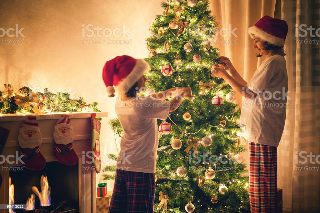 Family Decorating Christmas Tree stock photo