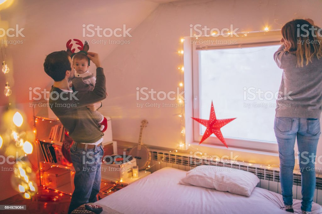 Family decorating for Christmas stock photo