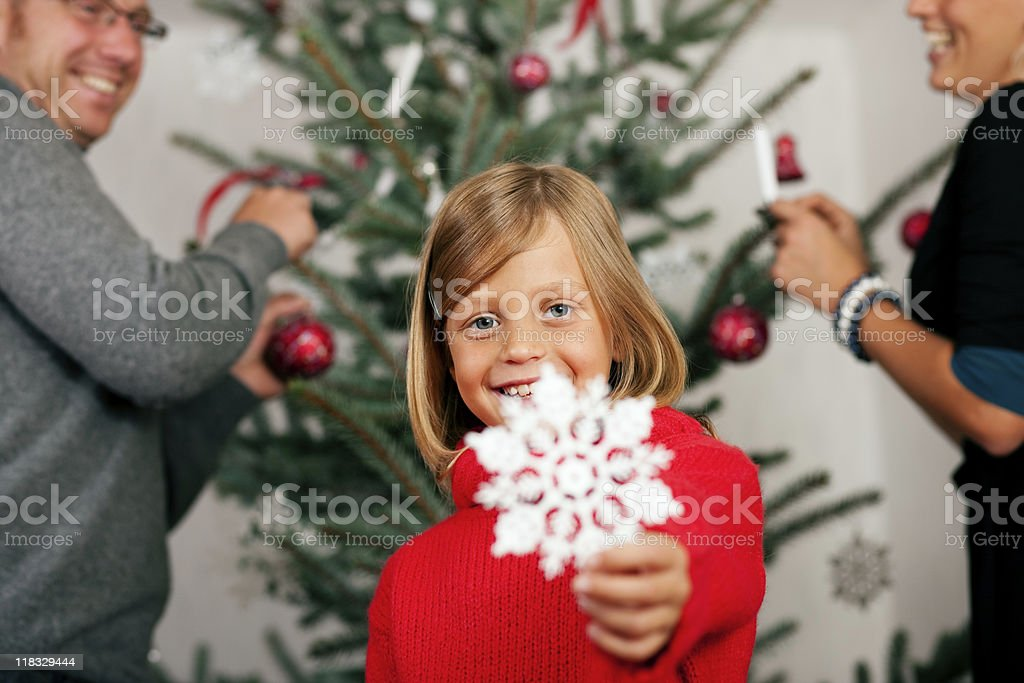 Family decorating the Christmas Tree royalty-free stock photo
