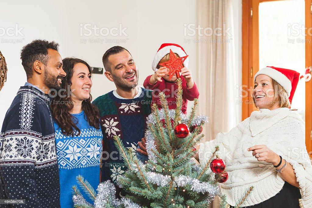 Family Decorating the Christmas Tree stock photo
