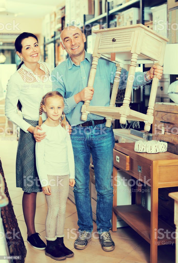 Family demonstrating curbstone in store stock photo
