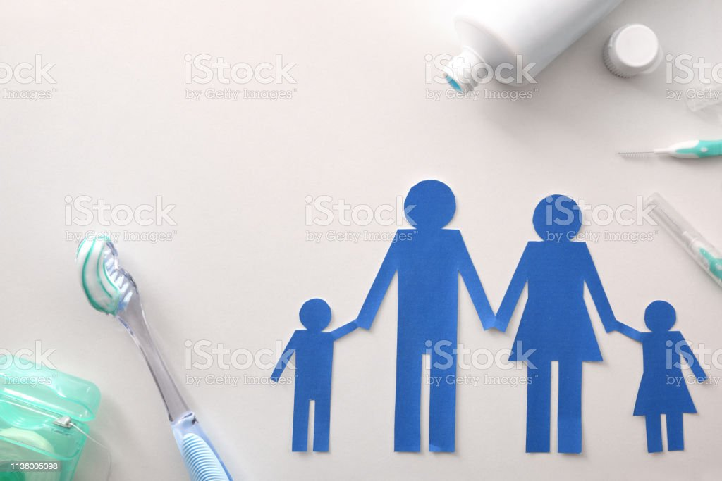 Family dental hygiene with tools on white table top stock photo