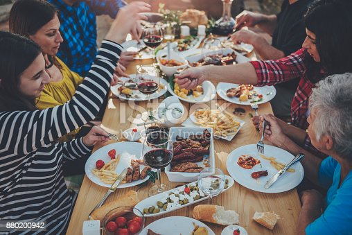 istock Family dining outdoor 880200942