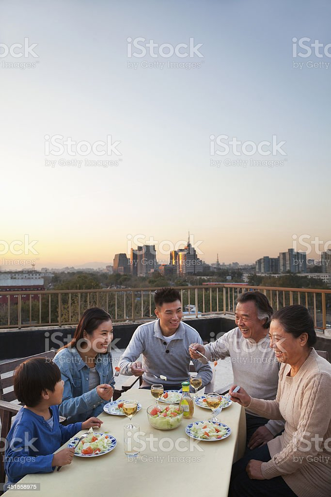 Family Dinner on Rooftop stock photo