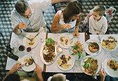 Overhead shot of family having dinner in a restaurant.