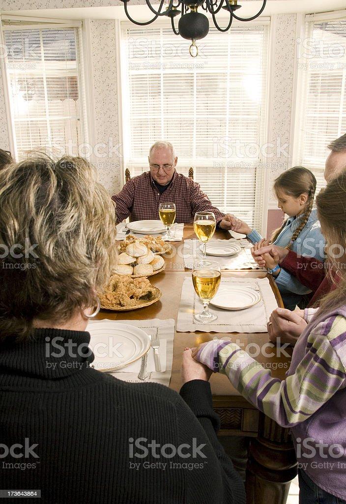 Family Dinner Series- Grandparents praying royalty-free stock photo