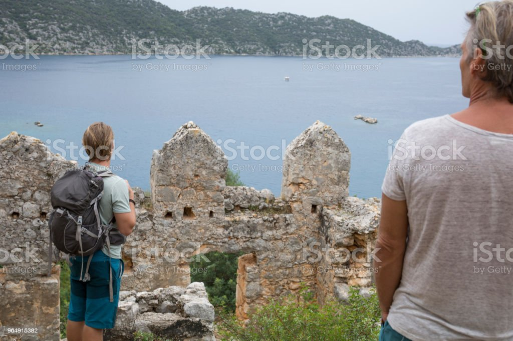 Family discover ruins above sea royalty-free stock photo