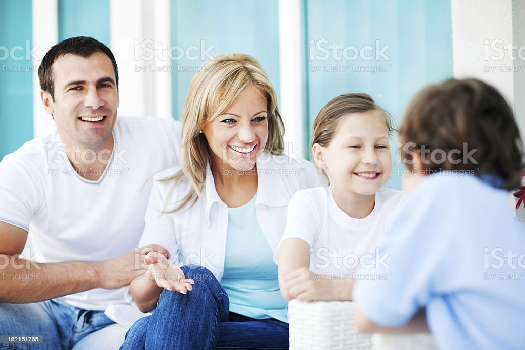 Family discussing on the terrace. royalty-free stock photo
