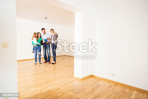 istock family discussing with their interior designer 530863535