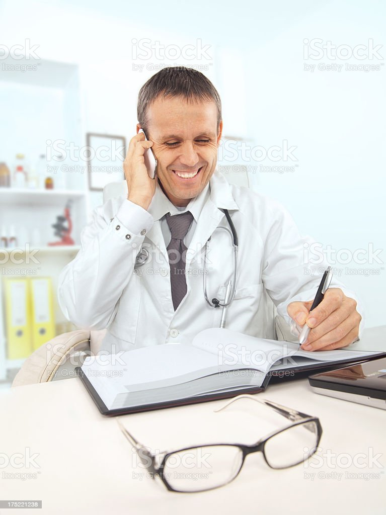Family doctor talking on the phone royalty-free stock photo