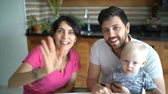 istock Family doing a video chat at home 1218830239