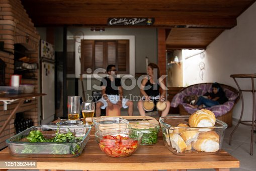 istock family doing barbecue and playing drum 1251352444