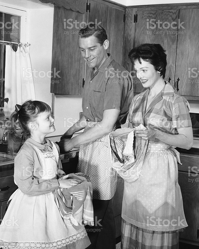 Family doing dishes royalty free stockfoto