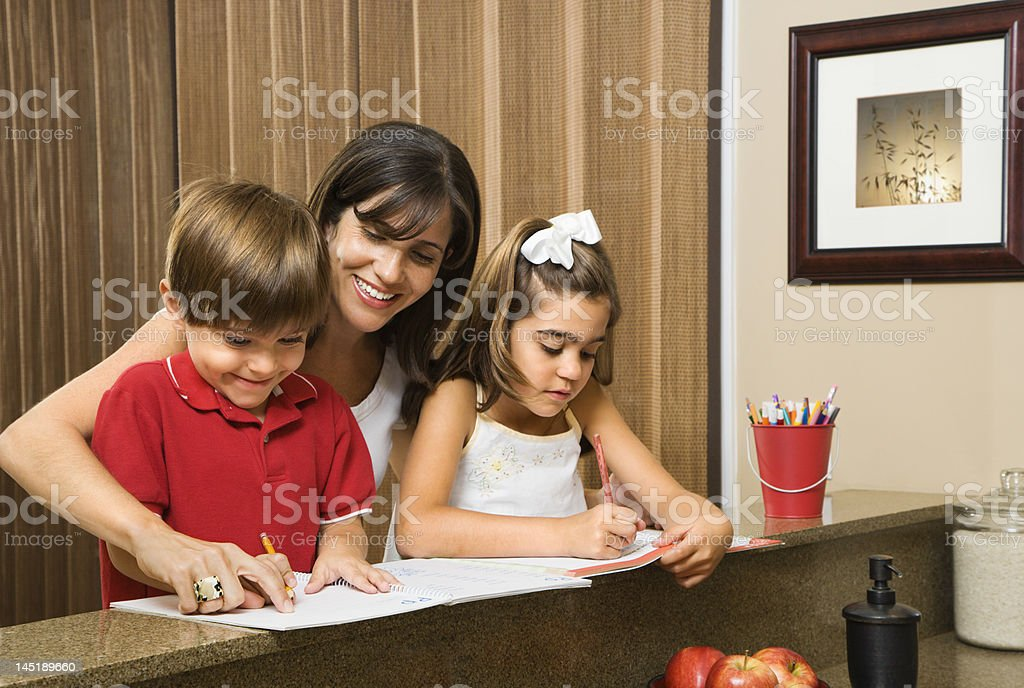 Family doing homework. royalty-free stock photo