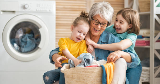 family doing laundry stock photo