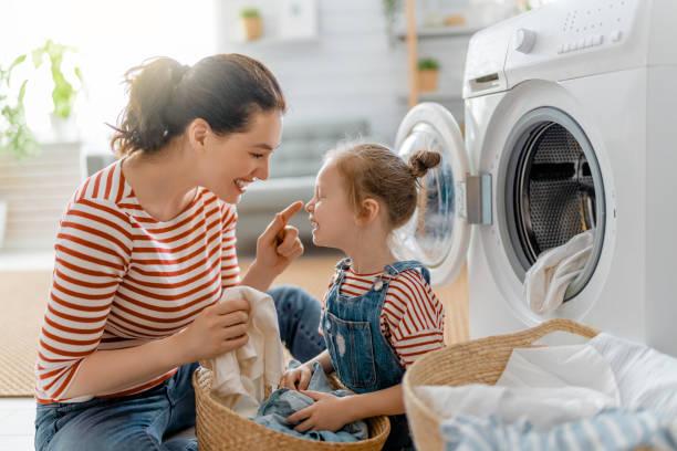 family doing laundry stock photo