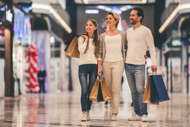 family doing shopping - shopping mall stock photos and pictures